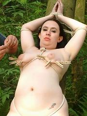 Public bondage - BBW tied to a tree